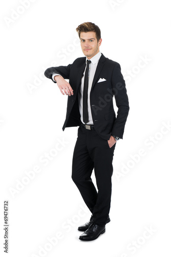 Fotografía  Confident Businessman Leaning On Invisible Wall