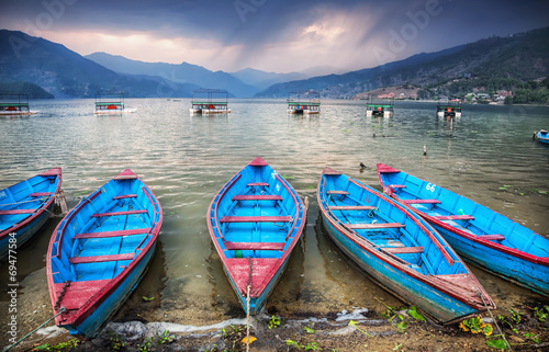 Wall Murals Nepal Boats near Pokhara lake