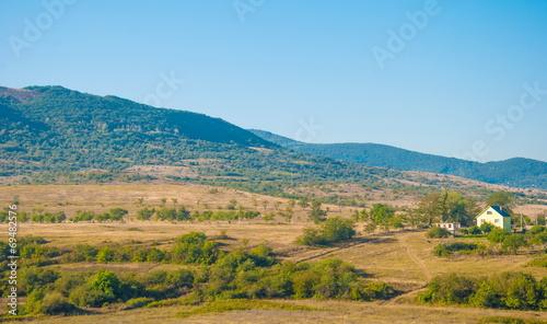Foto op Plexiglas Zuid Afrika Landscape with mountain valley with farm, garden and meadow