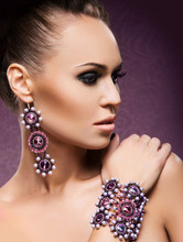 Young, Beautiful And Rich Woman In Jewels Of Gold And Stones
