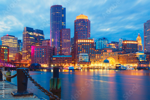 Leinwand Poster Boston Harbor and Financial District at sunset.