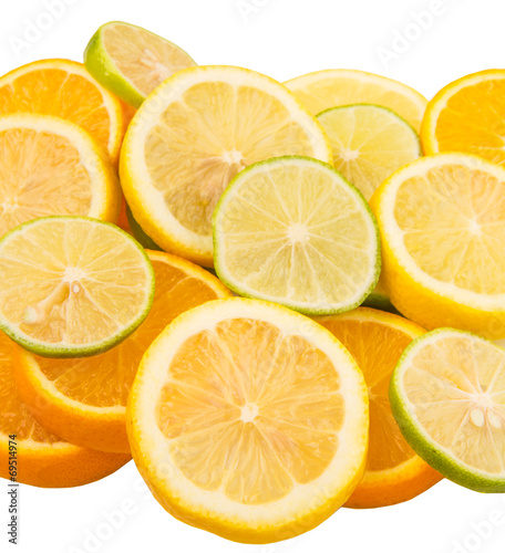 Photo Stands Slices of fruit Lime, lemon and orange layer slices over white background
