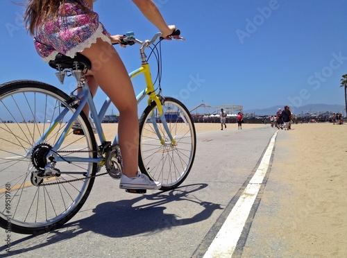 Poster Los Angeles Pretty Woman riding a bicycle along Santa Monica Beach pathway