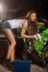 Obraz na płótnie Canvas Woman washing motorcycle