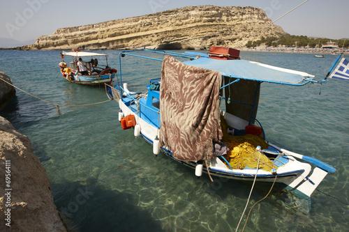 Matala beach with fishing boats in Crete. Greece