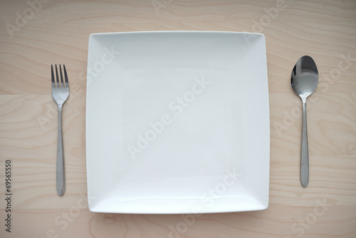 Square plate on wooden table