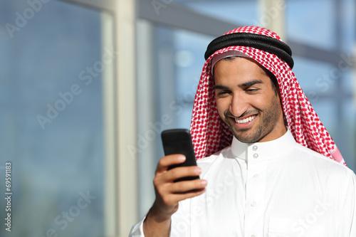 Arab saudi businessman working  with his phone Wallpaper Mural