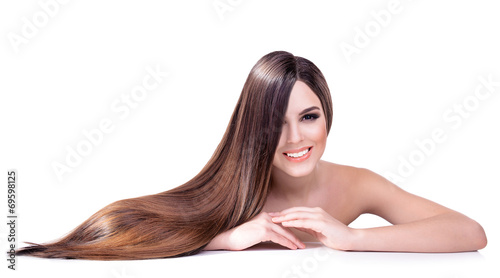 Fotografie, Obraz  Beautiful young woman with long hair isolated on white