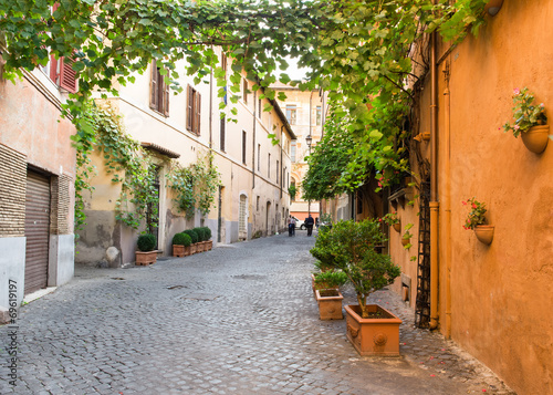 Old street in Trastevere in Rome, Italy #69619197