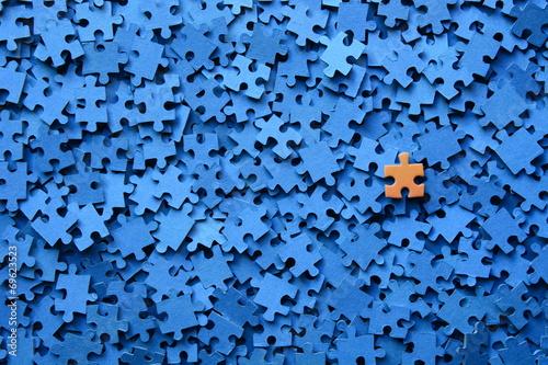 Fotografía  Pieza De Puzzle Sobre Fondo Azul