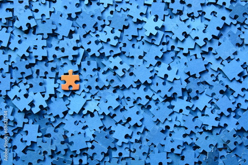 Fotografia  Pieza De Puzzle Sobre Fondo Azul