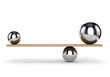 Metal balls balanced on plank