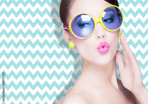 Fotografie, Obraz  Attractive surprised young woman wearing sunglasses