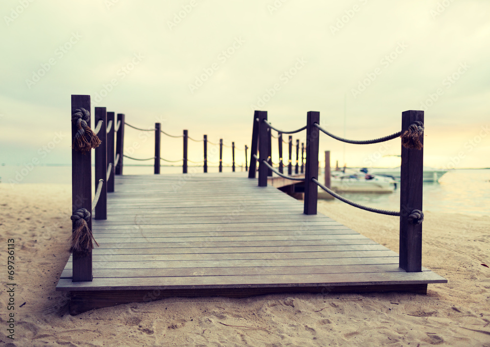 close up of pier on tropical beach