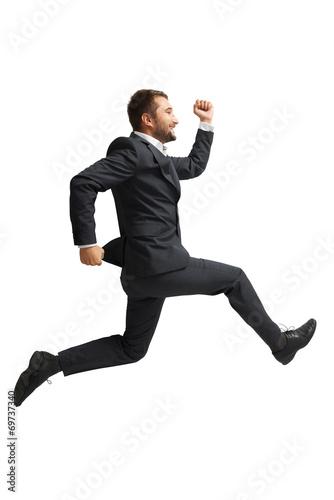 Foto  Lachender Geschäftsmann läuft