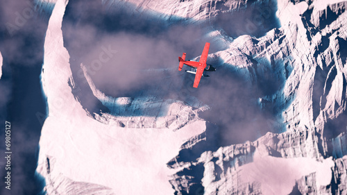 Foto op Aluminium Luchtfoto Aerial of red airplane flying over arctic snow landscape with bl