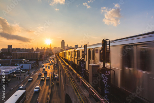 Subway Train in New York at Sunset плакат