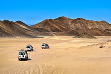 Landscape Of Sahara Desert With Jeeps For Safari.