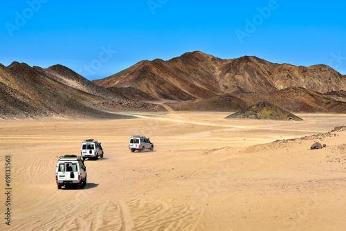 Landscape of Sahara desert with jeeps for safari. Fototapeta