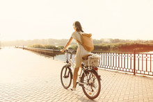 Girl Riding A Bicycle In Park ...