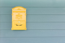 Yellow Mailbox With Green Wood...