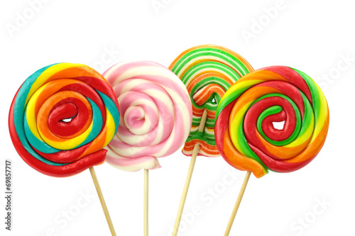 Colorful spiral lollipops on white background Poster