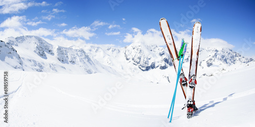Fotografija Skiing , mountains and ski equipments on ski run