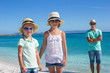 Young beautiful family of three on tropical vacation