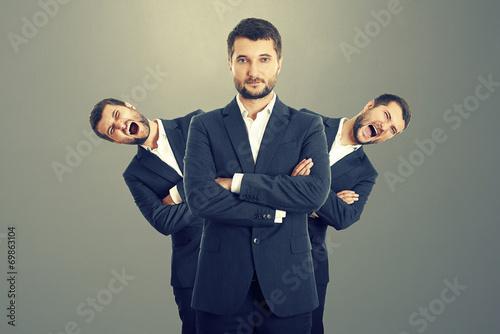 Obraz na plátně screaming men behind confident businessman