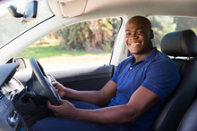 African Man Inside His New Car