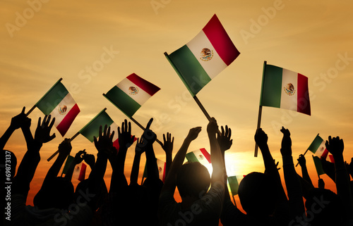 Fotografie, Obraz  Silhouettes of People Holding Flag of Mexico