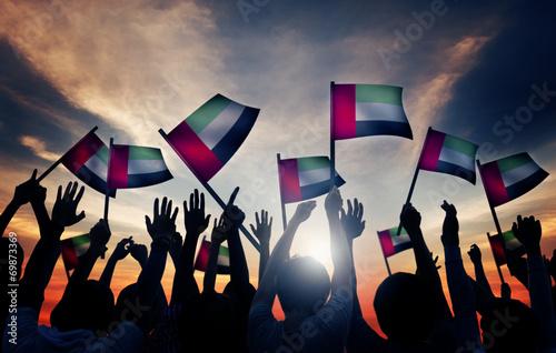 Fotografie, Obraz  Group of People Waving Flag of UAE in Back Lit