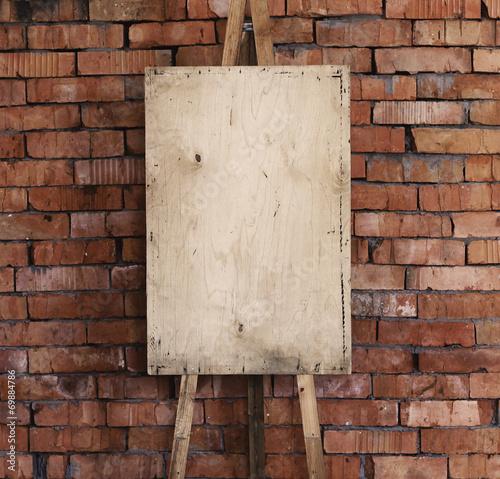 Photo  Easel art background, brick wall