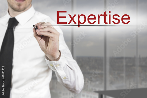 Láminas  businessman writing expertise in the air