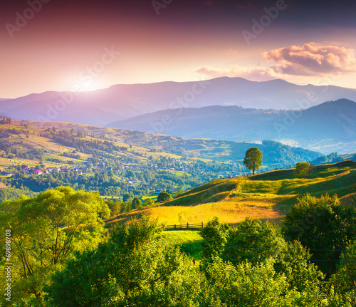 Foto op Canvas Zalm Beautiful summer landscape in the mountain village