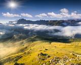 Colac mountain range at foggy summer morning. Dolomites mountain