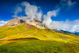 Sassolungo mountain range at sunny summer day.  Dolomites mounta