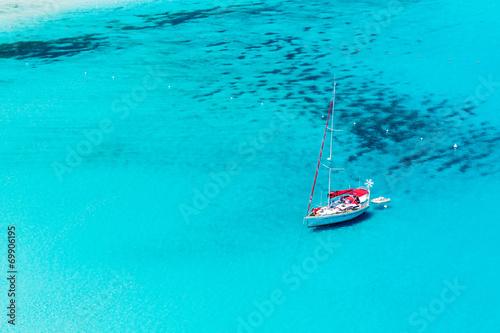 Sailboat anchored in Porto Giunco bay. Sardinia Island. Italy. Canvas Print