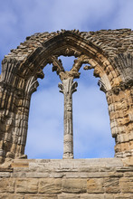 Whitby Abbey Ruins Against A B...