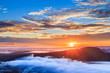 Sunrise at Pha Mo I Daeng Cliff and mist, Sisaket, Thailand