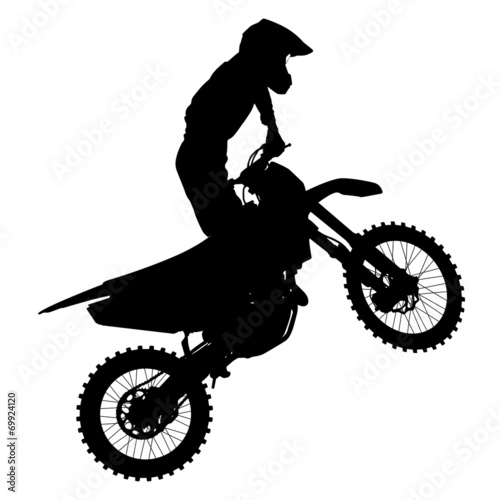 Photo  Black silhouettes Motocross rider on a motorcycle