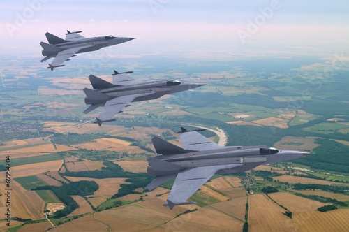 Photo  3d models of jet fighters flying above the rural landscape