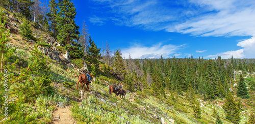 Photo  Trail riding in the Rocky Mountains