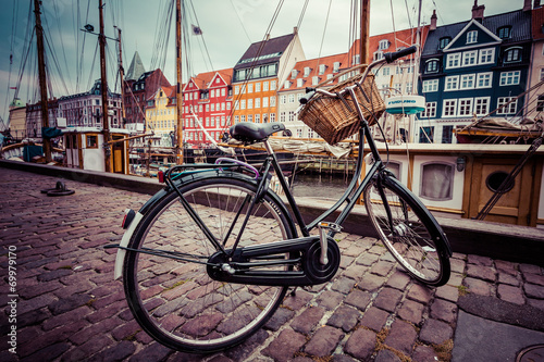 Classic vintage retro city bicycle in Copenhagen, Denmark Fototapeta