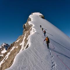 Fototapeta Climbing a mountain