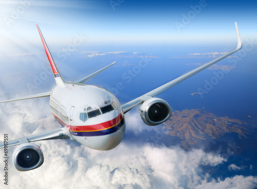 airplane in the sky with sunlight Wallpaper Mural