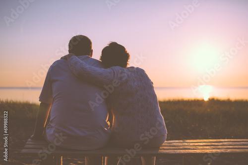 Fototapeta Senior couple enjoy the sunset together obraz