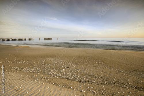 Wall mural - Morze,  plaża o wschodzie słońca