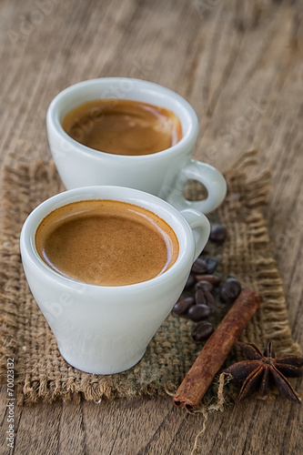 Foto op Canvas Chocolade Coffee cup and coffee beans on old wooden background