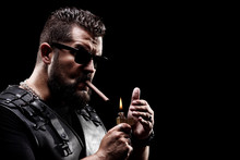 Badass Biker Lighting Up A Cig...